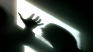 Silhouette of raised hand