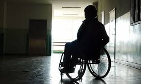 Silhouette of lady in a wheelchair
