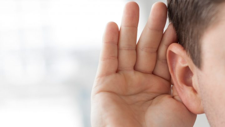 Hand cupped behind ear